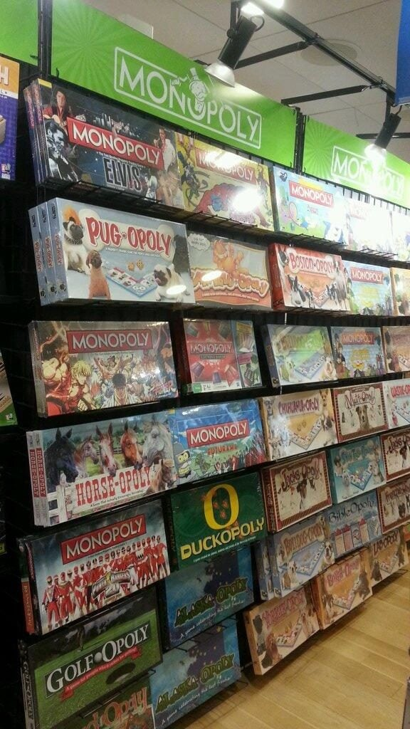 Actual picture of a Monopoly section at a board game store in a mall. 90% of these looked the same, from the materials inside to the back of the box!